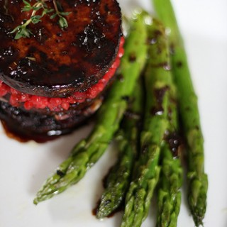 balsamic tofu on a plate with asparagus