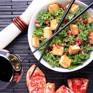 Raw Kale with Tofu Croutons and Pomegranate-Sesame Dressing