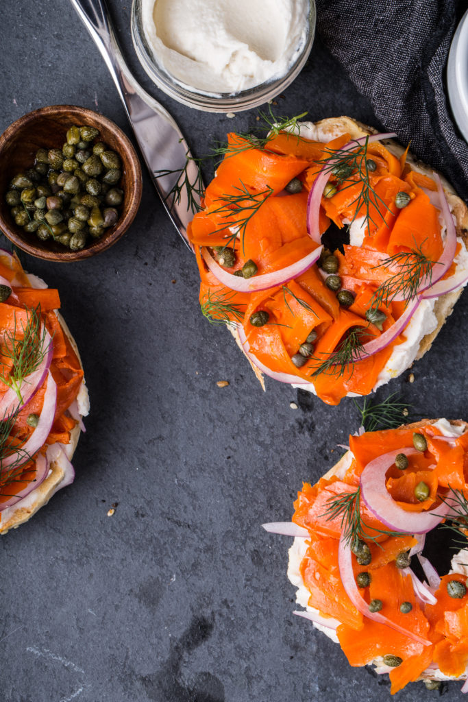 three carrot lox bagels, with red onion, capers and vegan cream cheese