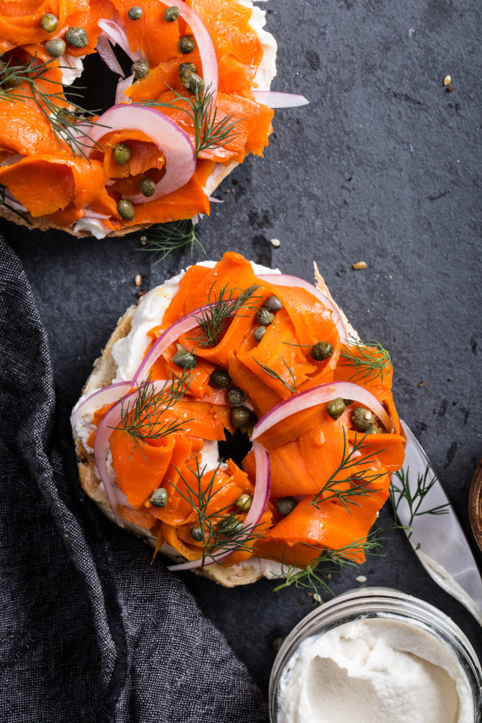 Closeup of carrot lox, shot top-down with capers