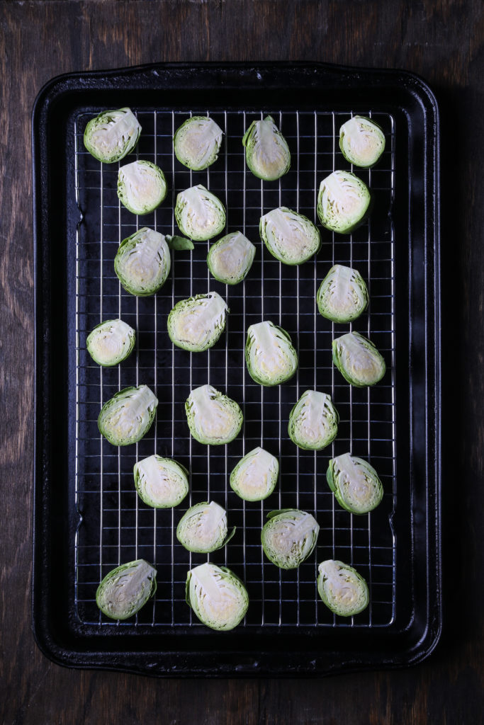 Halved Brussels sprouts, on a baking sheet