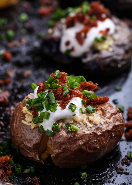 A close up shot of a smashed and loaded tiny potato