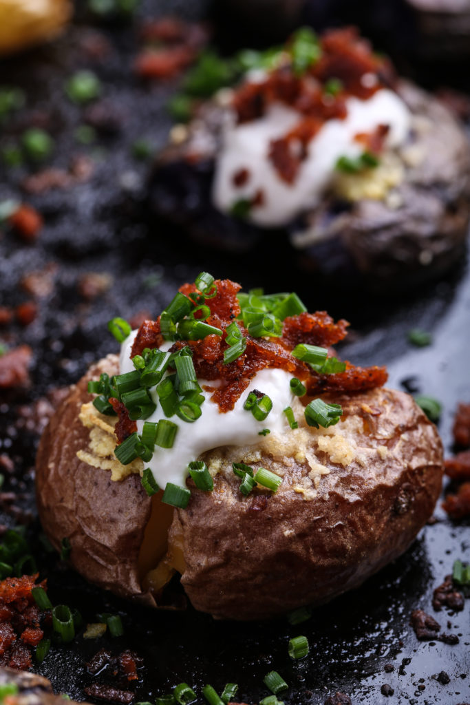 Close up shot of a smashed and loaded tiny potato from the side