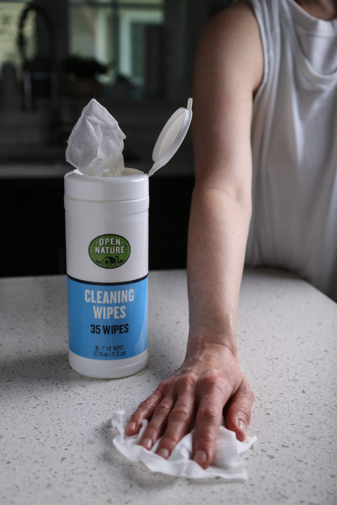 Hand wiping counter with cleaning wipe