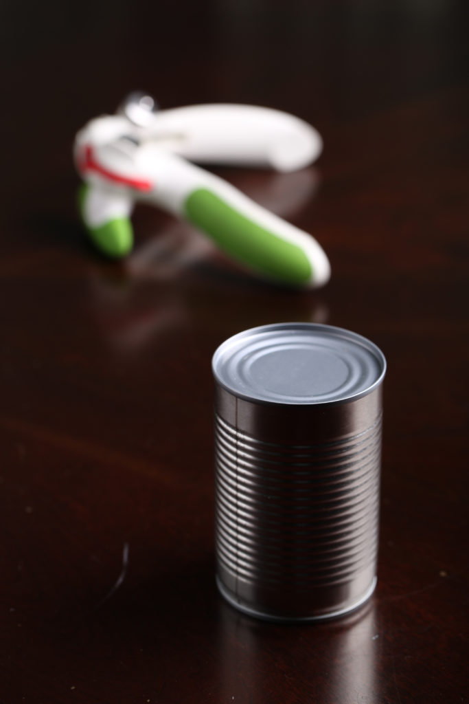 a can of coconut milk with can opener
