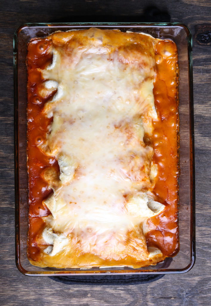 A top down shot of smothered burritos, straight from the oven