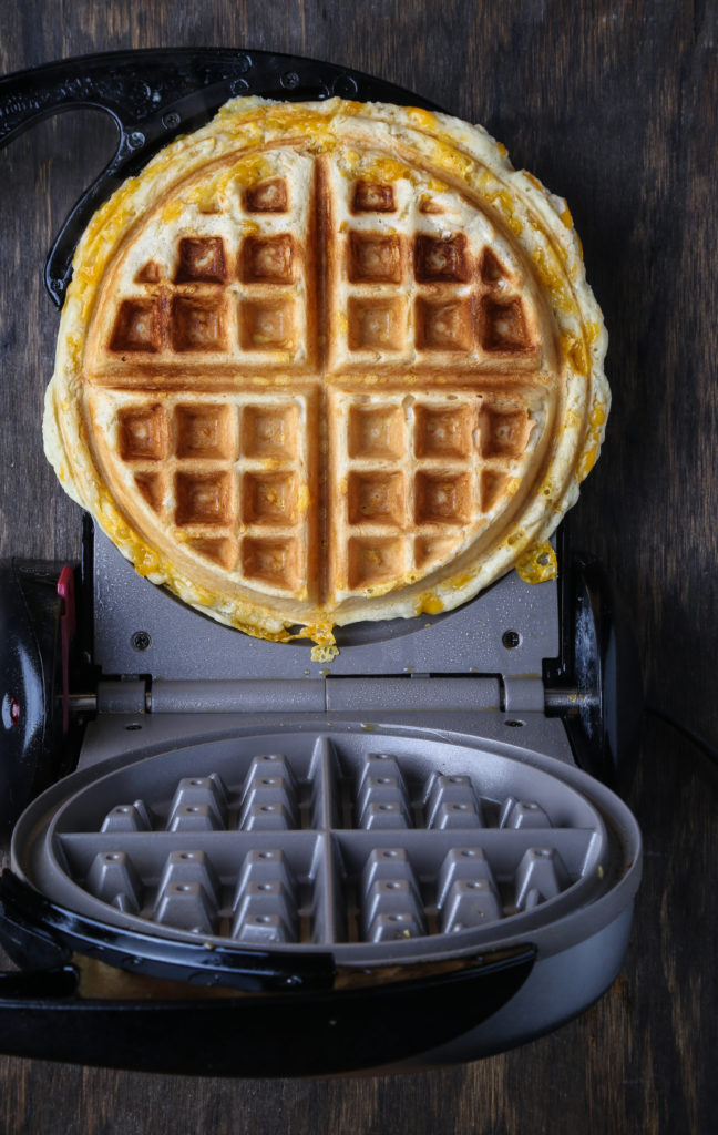 A vegan cheddar waffle ready for plating
